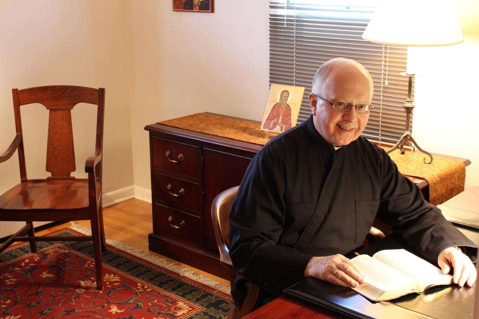 Father Wilbur David Ellsworth in his study
